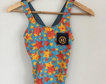 Super Cute full piece swimwear. Blue/Yellow/Orange star print. Denim look straps. XXS-XS