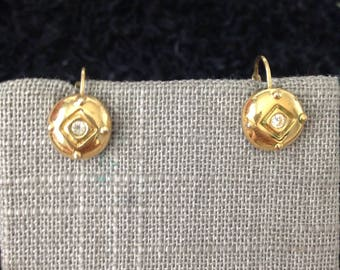 Vintage gold tone pierced earrings with small cz center