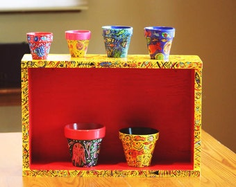 Recycled boxes and flower pots.