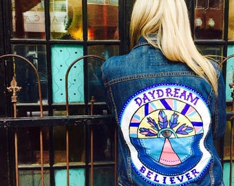 Daydream Believer denim hand painted jacket.  Size will fit a women's size 6-12 since it is an oversized jacket.
