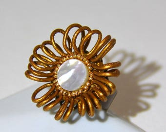 Swirls of gold leather ring