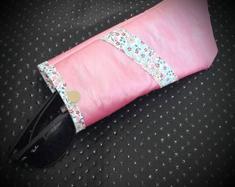 Soft pink sunglasses case with spring design.