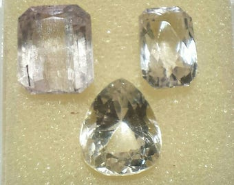 24.4ct lot of three faceted kunzites various cuts, lavender and yellow.