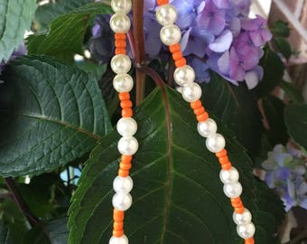 Pearl and coral beaded choker. Item is handmade.