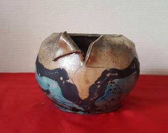 Ceramic pot fired at Raku method