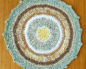 "Modern traditional, high quality, rag rug. Bath mat, nursery, dorm, kitchen, RV! Yellow/green/white/brown.  31"" circle"