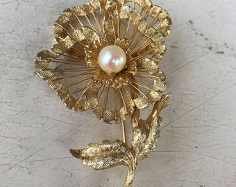 Brooks gold tone flower pin with faux pearl