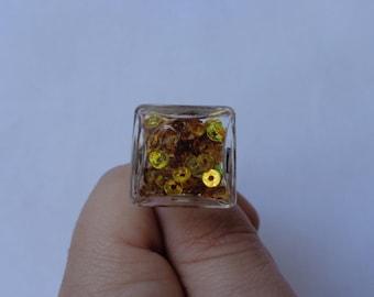 liquid glass globe ring gold glitter