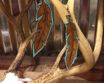 Tooled and painted leather feather earrings