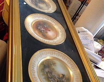 Patti Canaris collector plates in frame