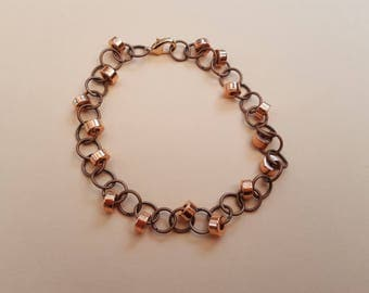 Handmade copper ring bracelet with rose gold coloured beads