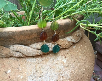 Long multi-colored drop leaf earrings made with glass beads.  Colors are green, brown and teal with silver toned ear wires