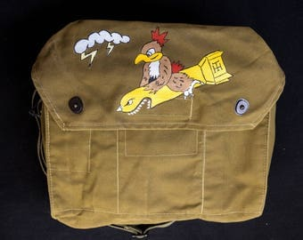 Vintage military canvas shoulder bag with nose art hand painted motif