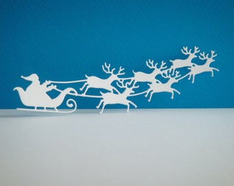 Cut Santa Claus and his reindeer in white design for scrapbooking and card paper