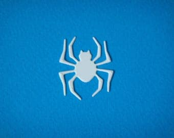 Cut little spider to create white drawing paper