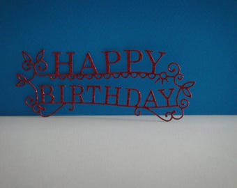 """Cut out """"Happy Birthday"""" red glitter for creation"""