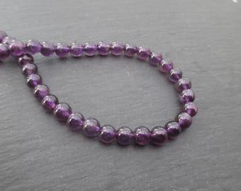 Grade A Amethyst: 8 round beads 6 mm