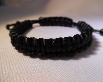 Tibetan man black silk thread bracelet. Adjustable.