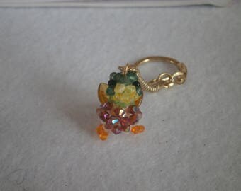 """Keyring """"Duck"""" synthetic pearls."""