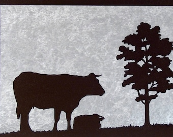 A cow and a tree, table silhouette in woodcut
