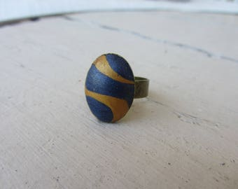 oval cabochon polymer clay striped gold and blue, holder bronze metal Adjustable ring