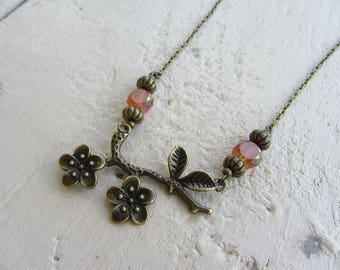 the Choker necklace rustic bronze flower and iridescent coral orange beads