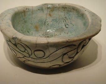 Beautiful glazed raku ceramic bowl