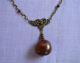 Bronze donkey eye and toloman findings on necklace