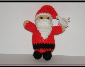 Amigurumi Santa Claus crocheted acrylic yarn.