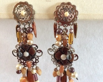 earring clips with Brown beads and puck flat snake pattern