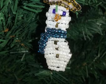 Small snowman made of seed beads