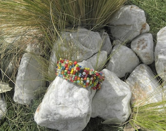 Bracelet embroidered with various and multi-colored beads