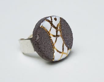 White glazed lava and twists of gold ring