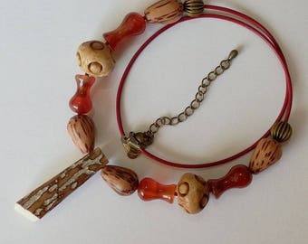 Manakel mixed M/F ivory dinosaur bone necklace carnelian wood Brown