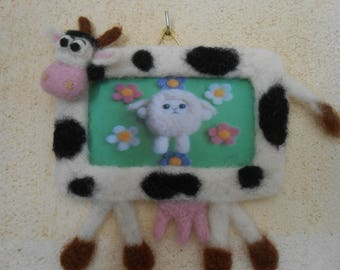 Felted wool cow picture frame.