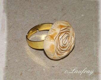Ring made of earthenware, pastel orange, gold ring