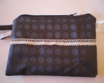 cosmetic case in coated black and lined white cotton