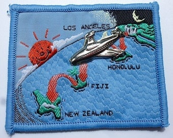 applique by Los Angeles New Zealand airmail with inserted silver 20-2 vintage metal badges