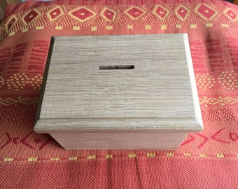 Secret wooden piggy bank