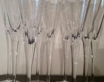 9 Crystal (cut) Champagne Flutes