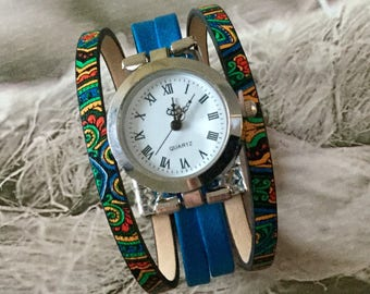 SIZE S Silver ladies watch.   round silvery blue electric and ethnic multicolored