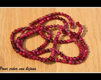 Set of 100 4mm pink speckled glass beads