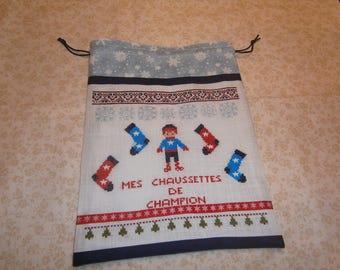 "Cross-stitched ""Champion socks"" bag"
