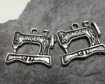 has 2 pcs machine sewing singer silver