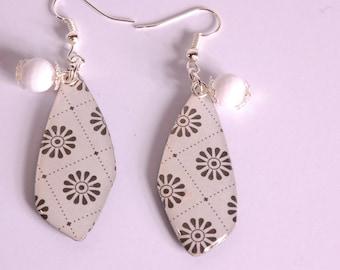 Black floral earrings, iridescent white