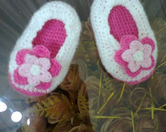 pair of crochet flower baby shoes