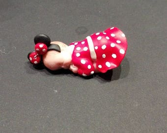 baby in polymer clay with a dress