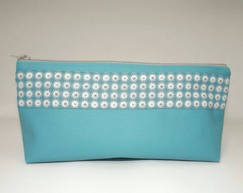 Faux turquoise leather makeup case.