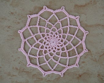 small pale pink round crochet doily