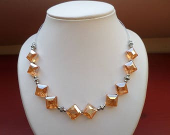 Necklace in diamond-shaped glass beads